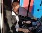 Konin. Kobieta w gustownej apaszce za kierownicą autobusu MZK