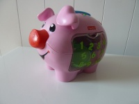 Świnka skarbonka z monetami Fisher Price