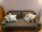 tanio sprzedam nowoczesną sofę w kolorze szarym