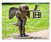 anioł z lampą