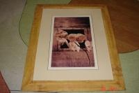 Sprzedam obraz w drewnianej ramie.